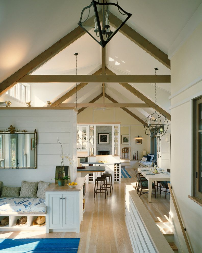 Stokes Lighting   Beach Style Family Room Also Cathedral Ceiling Clerestory Windows Exposed Trusses Great Room King Post Light Wood Floor Natural Lighting Orb Light Partial Wall Shiplap Wall Vaulted Ceiling Wood Trusses