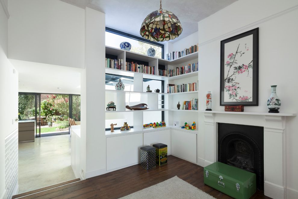 Stokes Lighting   Eclectic Living Room  and Asian Painting Asian Vases Books Built in Corner Bookcase Design Green Suitcase Interior Metal Tins Rear Extension Refurbishment Renovation Split Level Stain Glass Pendant Transom Windows White Fireplace Mantel