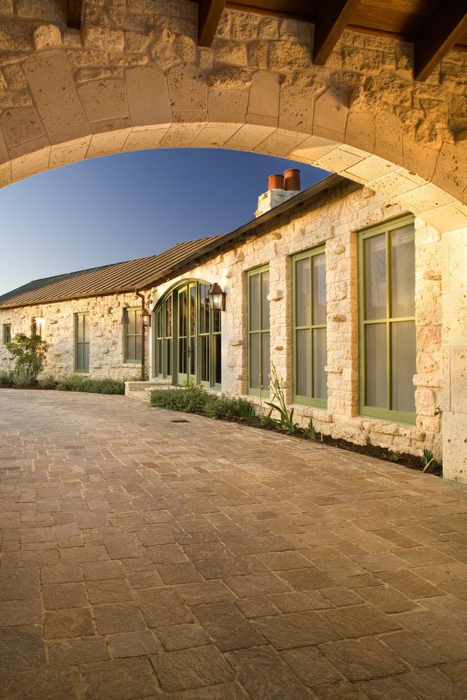 Stone Pavers for Sale   Rustic Exterior  and Archway Driveway Exposed Beams French Doors Glass Doors Green Trim Metal Roof Neutral Colors Outdoor Lighting Planters Rustic Standing Seam Roof Stone Paving Stone Wall Wall Lighting