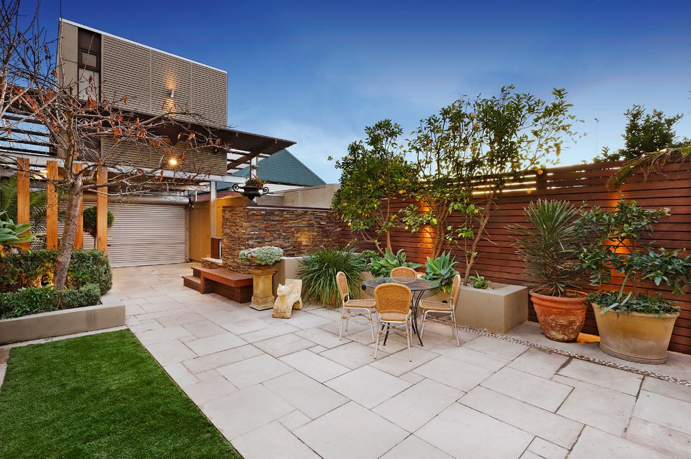 Stone Pavers for Sale with Contemporary Patio Also Built in B B Q Decorative Timber Fencing Exterior Exterior Lighting Grass Landscaped Garden Loft Above Garage Mass Planting Outdoor Furniture Patio Furniture Patio Pavers Potted Plants Stone Paving