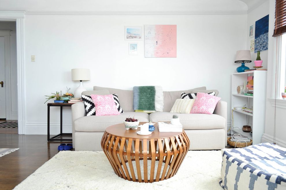 Stores Like West Elm   Eclectic Living Room  and Beige Couch Beni Ourain Rug Bentwood Coffee Table Black and White Pillows Bookshelf Colorful Pink Pillows Round Cocktail Table White Bookshelf White Table Lamp