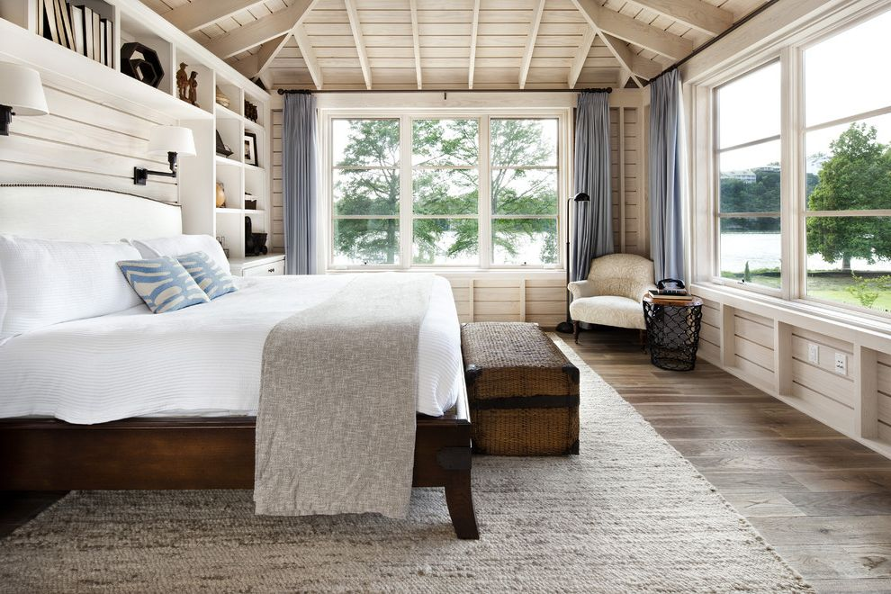 Stores Like West Elm   Rustic Bedroom Also Built in Bookcase Built in Shelves Built in Storage Cottage Curtains Drapes Reading Nook Rustic Sloped Ceiling Vaulted Ceiling White Bedding Window Treatments Wood Ceiling Wood Flooring Wooden Bed