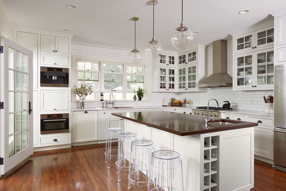 Stores Like West Elm   Transitional Kitchen  and Clear Bar Stools Dark Wood Countertop Glass Front Cabinets Glass Pendant Light White Countertop