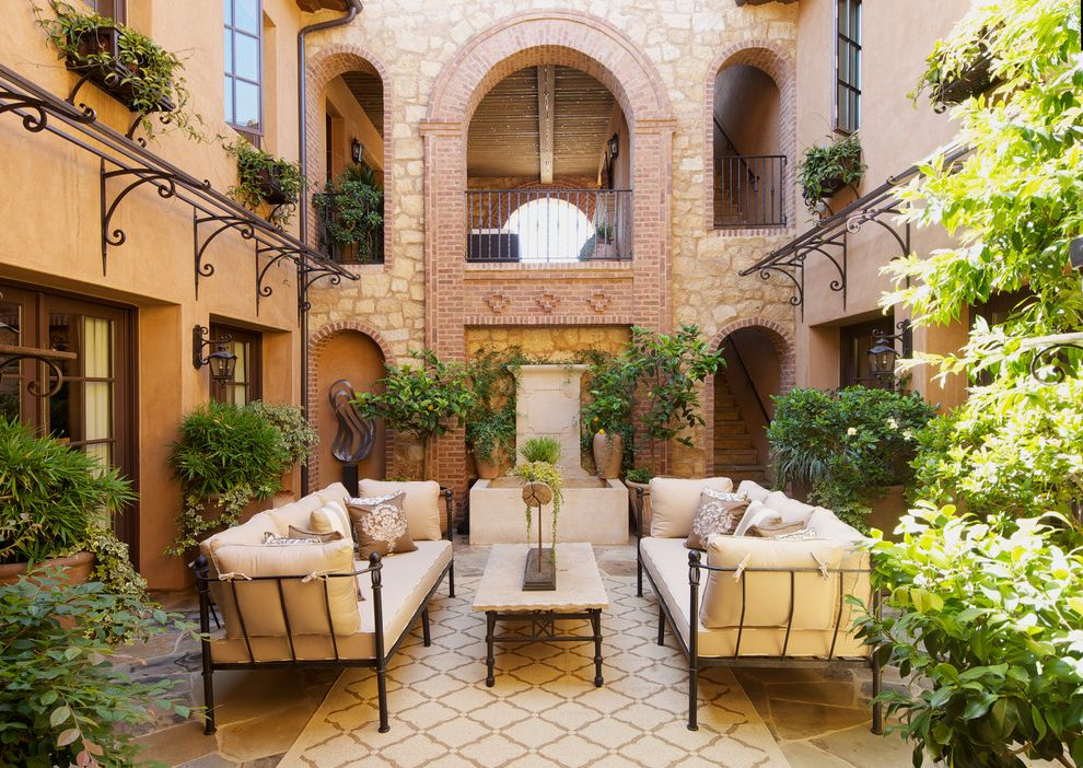 Stubborn in spanish with mediterranean patio and atrium for Tropical house plans with courtyards