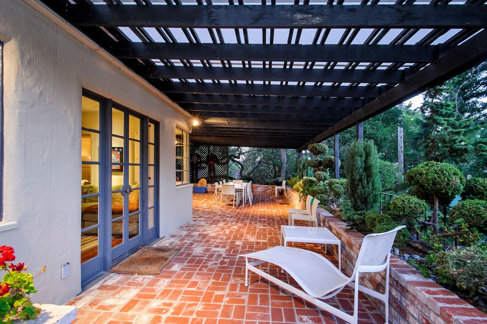 Stubborn in Spanish with Traditional Patio Also Brick Brick Retaining Wall Exterior Lighting Flowers French Doors Mass Planting Outdoor Chaise Lounges Outdoor Furniture Patio Patio Furniture Pergola