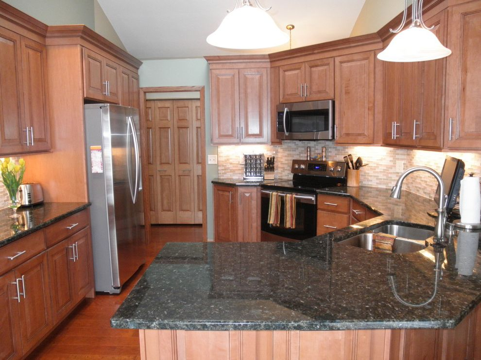 Suburban Waste Services Mn with Traditional Kitchen  and Backsplash Granite Counters Granite Countertops Hardware Maple Cabinets Maple Kitchen Maple Kitchen Cabinets Stainless Steel Appliances Tile Backsplash