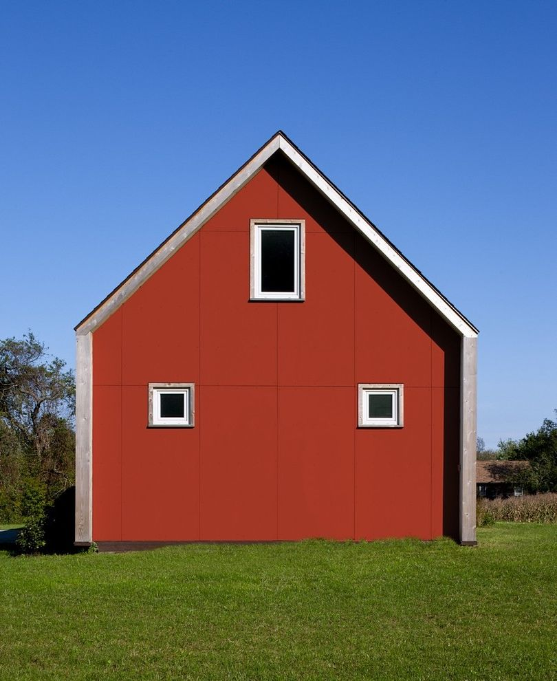 Sun Country Airlines Reviews with Farmhouse Exterior  and Barn Elevation Fiber Cement Gable Grass Green Home Lawn Leed Passive House Red House Turf