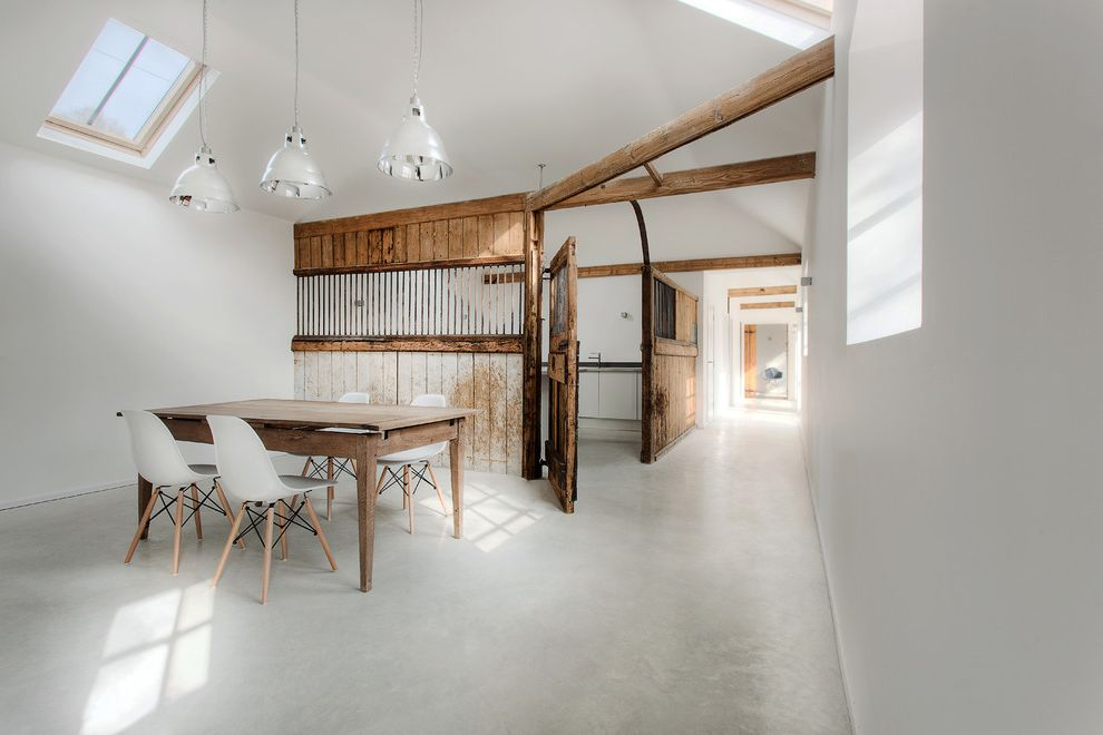 Sun Touch Heated Floor with Modern Dining Room Also Ar Chrome Pendant Lights Concrete Floor Contemporary Conversion Exposed Beams Farm Table Kitchen Old and New Rustic Wood Sky Lights Stable Bars Stables Timber Frame White Walls