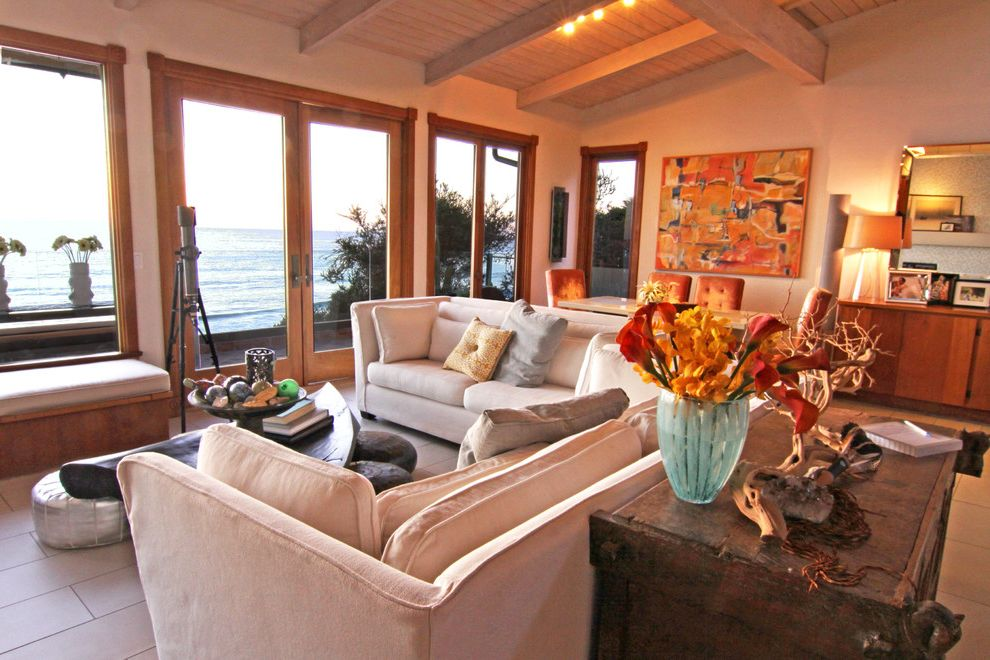 Sunrise Global Marketing   Eclectic Family Room Also Artwork Beach Beams Bench Seat Chest Coffee Table Mirror Oceanfront Pillows Seating Area Sofa Table Lamp Telescope Tile Floor Trunk Vaulted Ceiling Water View Wood Ceiling Wood Trim