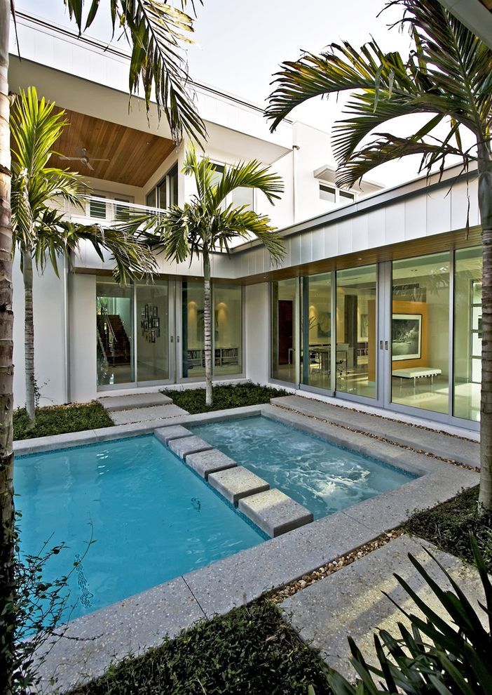 Superior Pool and Spa with Modern Pool  and Balcony Ceiling Fan Concrete Pavers Concrete Pool Pavers Concrete Pool Trim Concrete Steps Flat Roof Floor to Ceiling Windows Modern Pool Palm Tree Pool Sliding Glass Door White Exterior Wood Ceiling