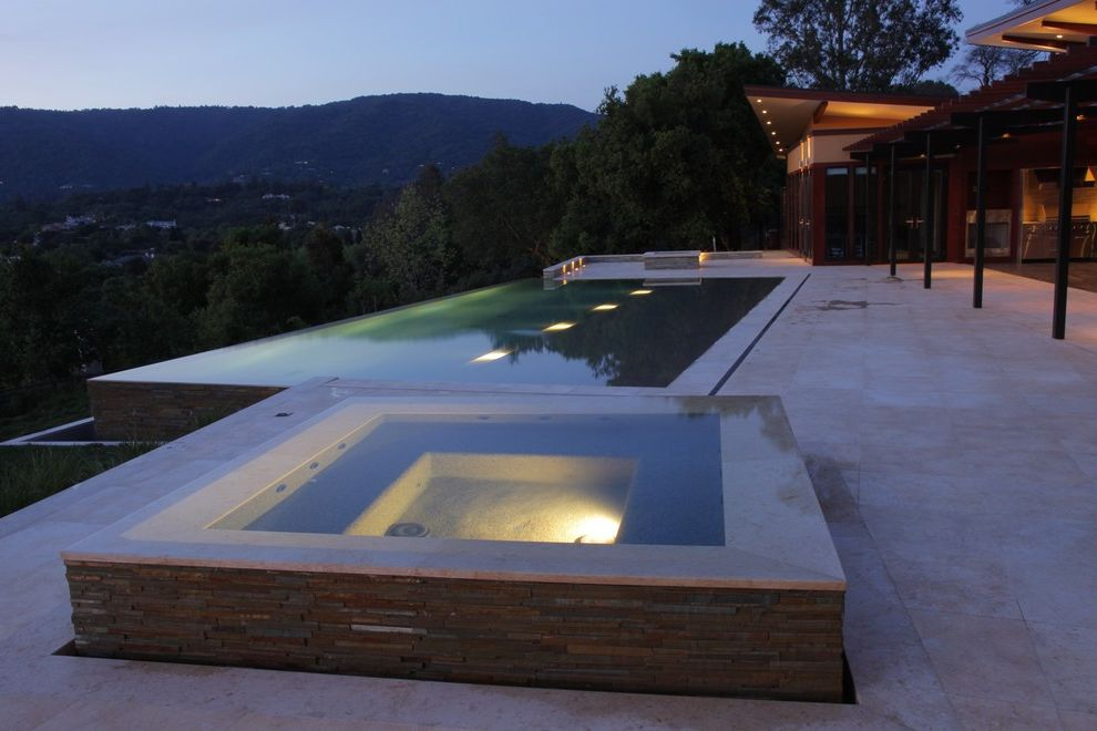 Superior Pool and Spa with Modern Pool  and Ceiling Lighting Disappearing Edge Pool Geometric Geometry Hillside Hot Tub Infinity Pool Jacuzzi Minimal Outdoor Lighting Overhang Patio Recessed Lighting Slope Spa Stacked Stone Terrace View Zero Edge Pool