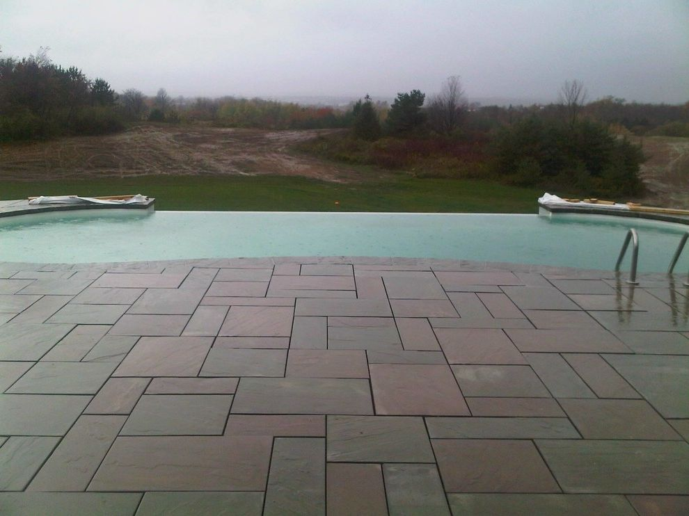 Surfside Pools    Pool  and Grass Area Infinity Pool Outdoor Living Stone Pavers