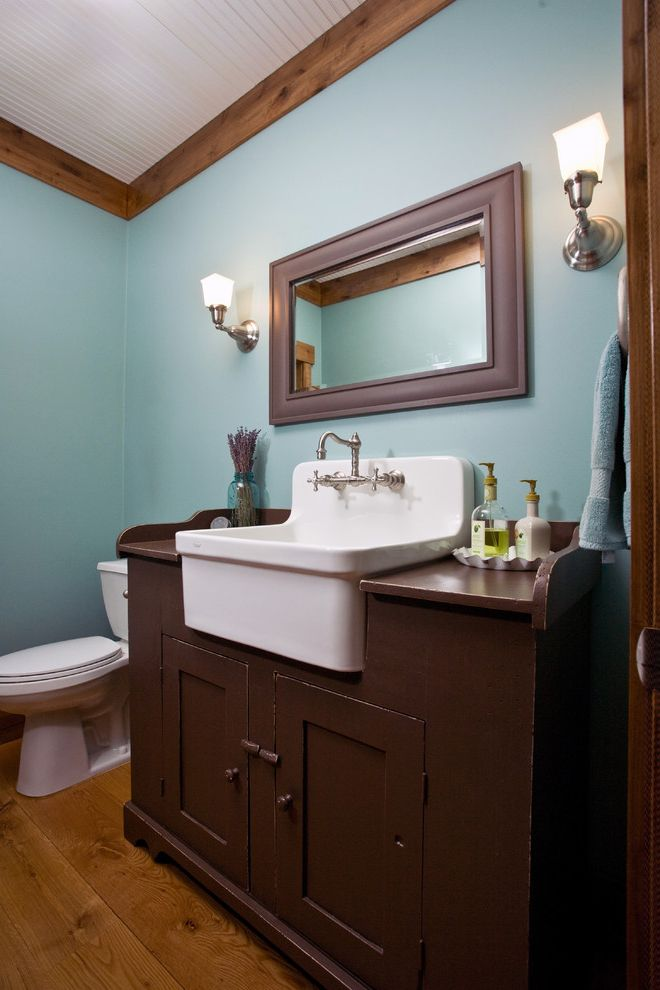 Swedish Mill Creek   Farmhouse Bathroom Also Blue Wall Brow Painted Vanity Chrome Chrome Faucet Cottage Farmhouse Farmhouse Sink Porcelain Sink Solid Wood Vanity Vanity Wood Floor Wood Trim