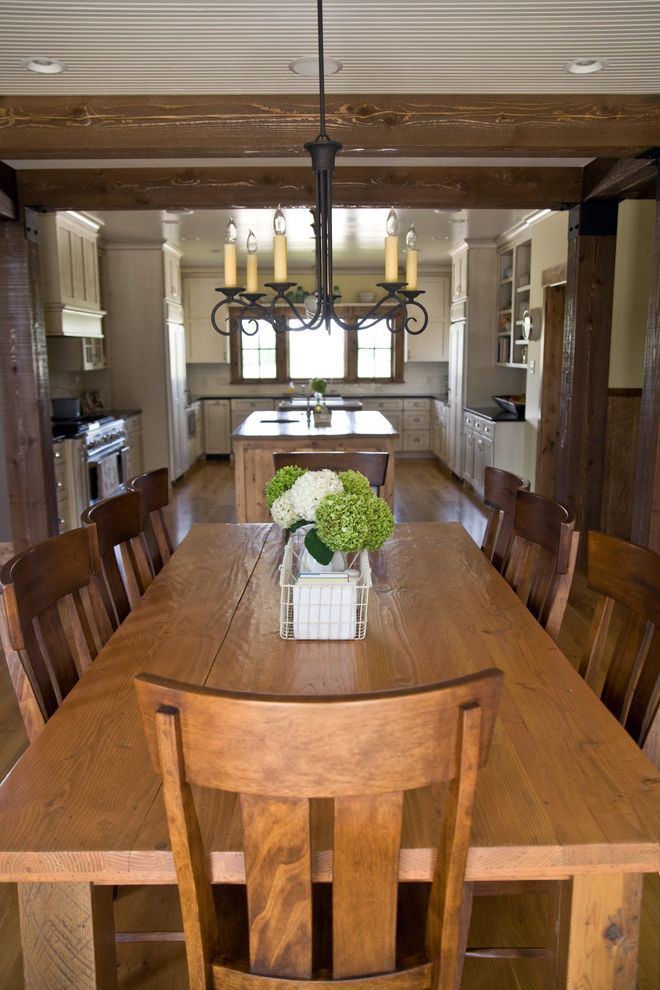 Swedish Mill Creek   Farmhouse Dining Room  and Chandelier English Cottage Farmhouse Kitchen Iron Chandelier Kitchen Kitchen Island Rustic Rustic Chair Table with Rustic Wood Wood Beam