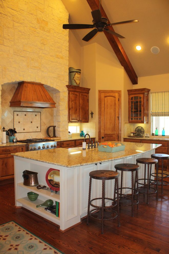 Swedish Mill Creek with Traditional Kitchen  and Area Rug Barstools Breakfast Bar Ceiling Fan Exposed Beam Island Kitchen Appliances Kitchen Countertops Stone Wall Tile Backsplash Wood Floors