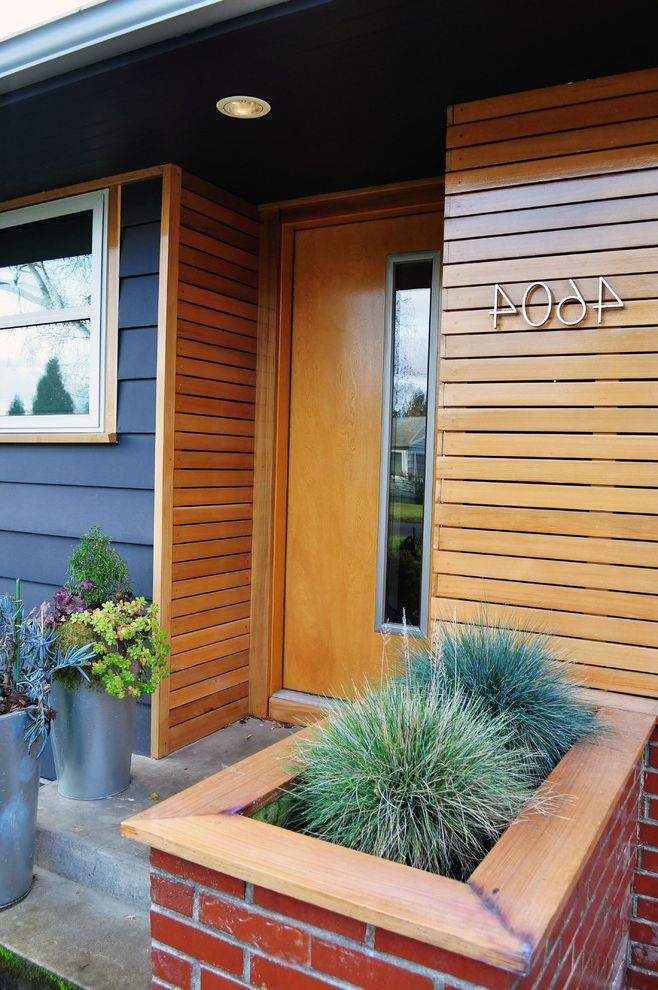 T1 11 Cedar Siding   Midcentury Entry  and Brick Planter Cedar Concrete Paving Design Build Facade Design Front Stoop Grasses Horizontal Slat House Numbers Mid Century Modern Pacific Northwest Portland Succulents Wood Front Door Wood Siding