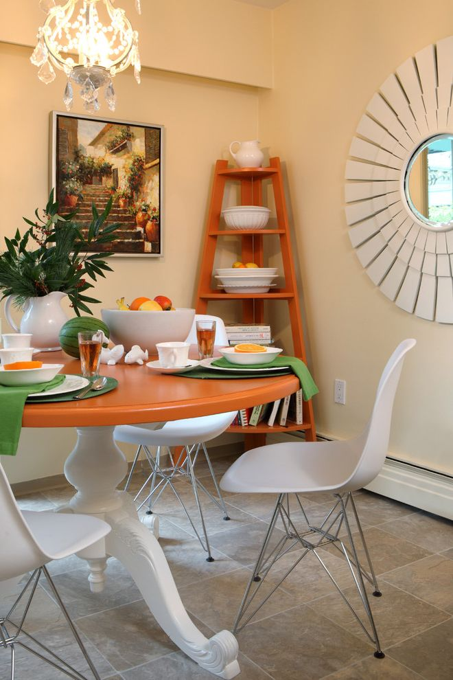 Table with Shelf Underneath   Eclectic Dining Room  and Chandelier Eiffel Chairs Kitchen Dining Area Orange Corner Bookshelf Sunburst Mirror Table Setting Tangerine Round Table Taupe and Peach Lino Flooring Yellow Walls
