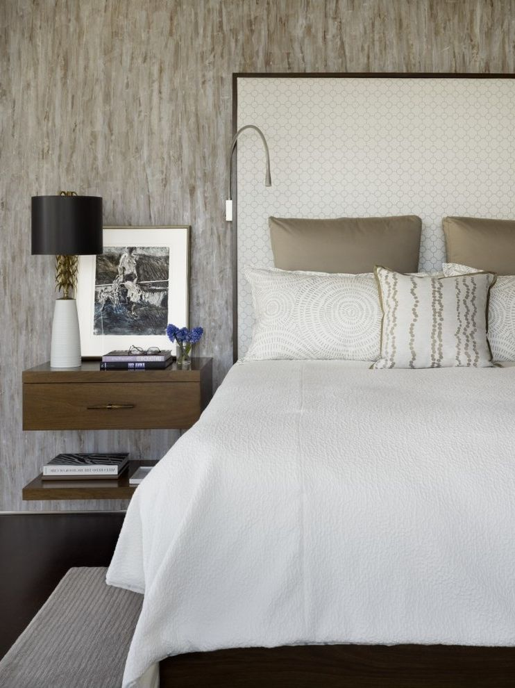 Table with Shelf Underneath with Contemporary Bedroom  and Neutral Palette Textured Walls Wall Mounted Bedside Table White Bedding White Headboard