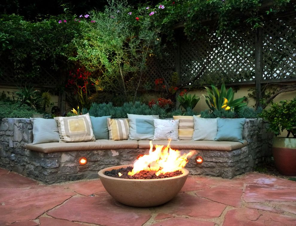 Tabletop Fire Bowl with Mediterranean Patio Also Contemporary Garden Drought Tolerant Succulents Fire Bowl Fire Pit Flagstone Mediterranean Garden Olive Tree Outdoor Lighting Outdoor Seating Pavers Seating Area Stone Bench Sunbrella Cushions