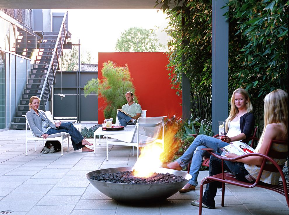 Tabletop Fire Bowl with Modern Patio  and Accent Wall Courtyard Fire Bowl Multiple Seating Areas Outdoor Firepit Outdoor Staircase Patio Furniture Red Wall Steel Beams