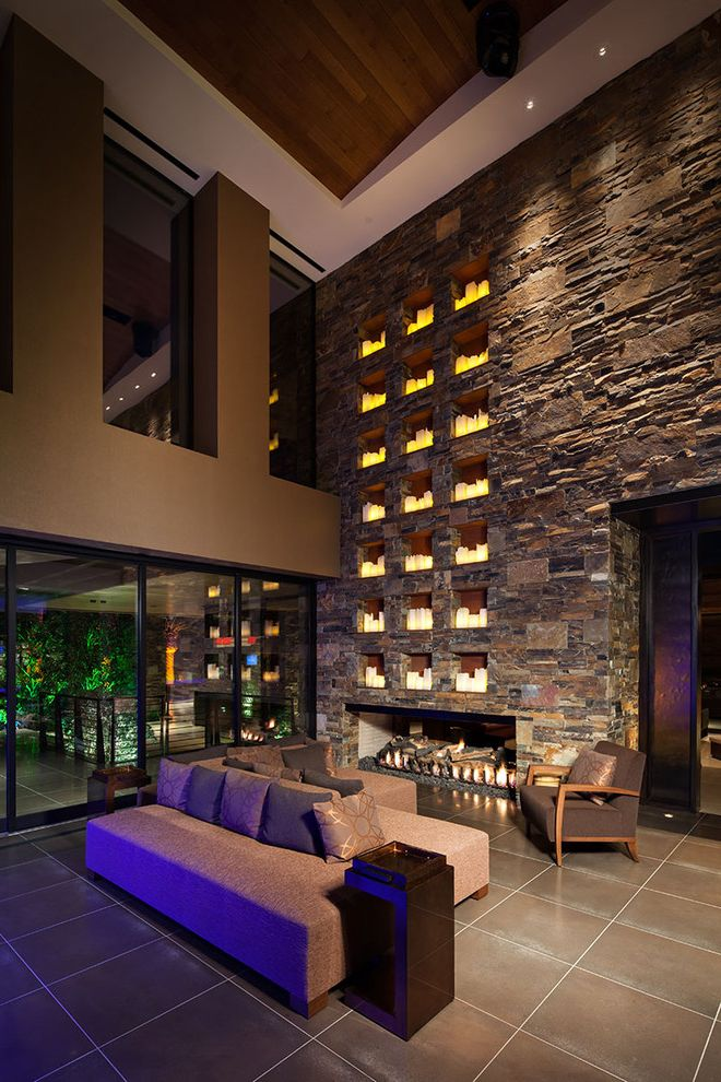 Tall Candle Pillars   Contemporary Family Room Also Armless Sofa Brown Candles Fireplace Niches Pillows Rock Wall Sliding Glass Doors Soffit Stacked Stone Stone Wall Tan Tile Floor Vaulted Ceiling Wood Ceiling