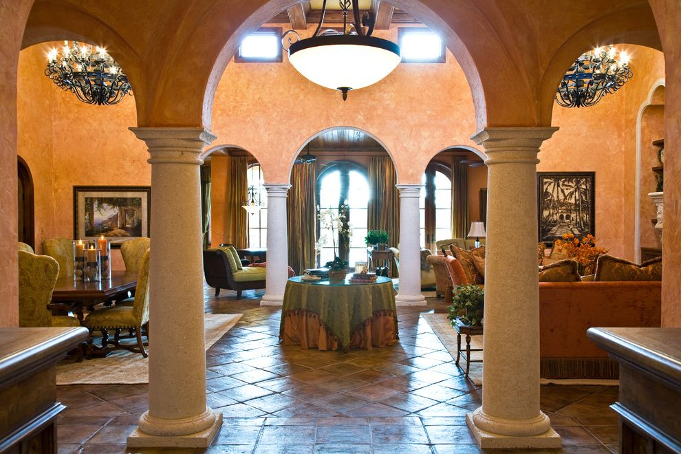 Tall Candle Pillars   Mediterranean Living Room Also Archway Bowl Chandelier Clerestory Columns Earth Tone Colors Faux Finish Great Room Open Floor Plan Peach Walls Tan Walls Tile Flooring Wood Trim