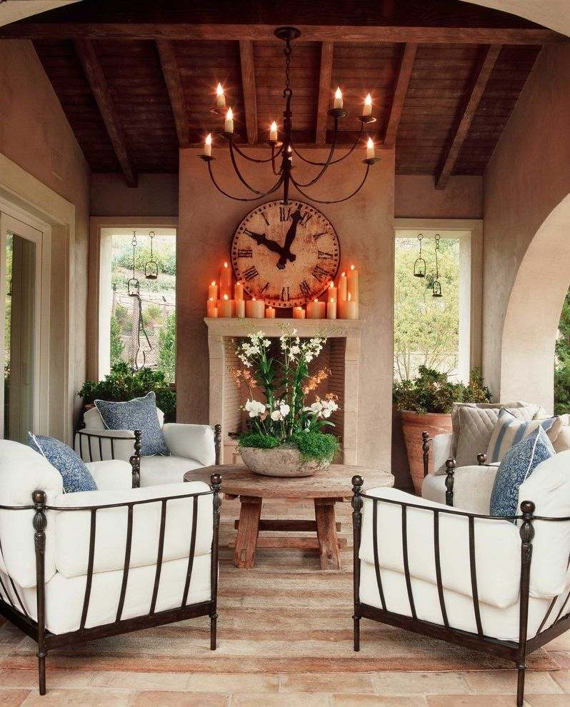 Tall Candle Pillars   Shabby Chic Style Patio Also Arched Doorway Brick Brick Floor Covered Patio Fireplace Iron Furniture Rustic Terra Cotta Vaulted Ceiling Wood Ceiling Wood Table