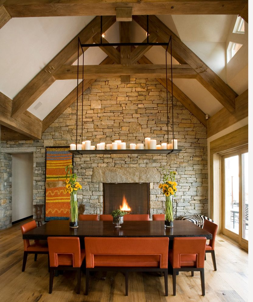 Tall Candle Pillars with Rustic Dining Room  and Chandelier Clerestory Windows Dining Table Light High Ceiling Upholstered Dining Chair Vaulted Ceiling Wood Trusses