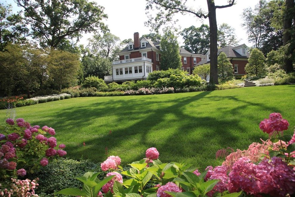 Tatum Lawn Care with Traditional Landscape and Border Planting Brick House Flowering Border Grass Hillside Hydrangea Lawn Lawn Panel Perennial Pink Flowers Slope Turf