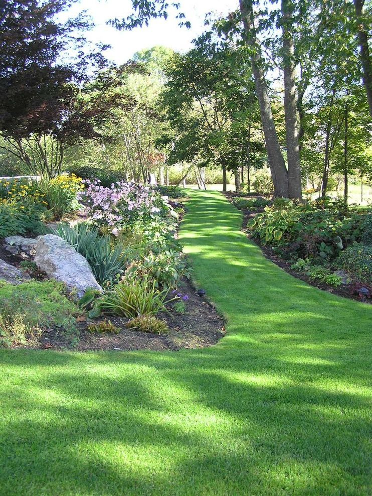 Tatum Lawn Care with Traditional Landscape and Border Plantings Boulders Garden Grass Lawn Path Playset Rocks Turf Walkway
