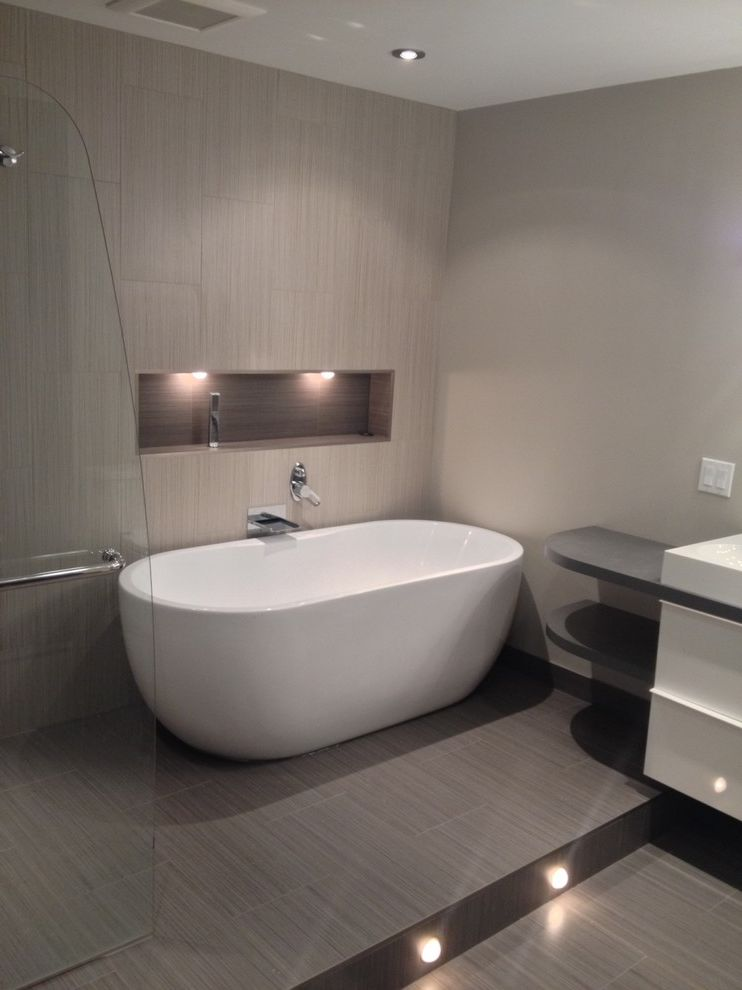 Taylored Restoration with Contemporary Bathroom  and Bathtubs