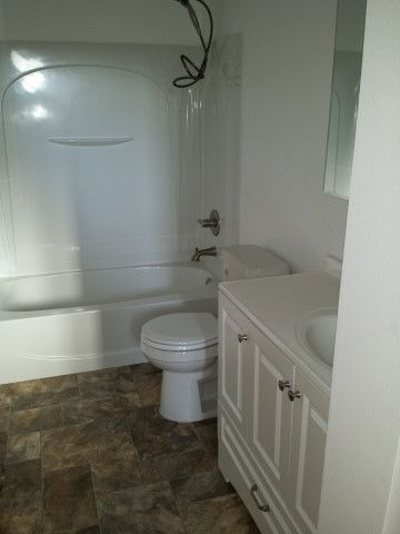 Taylored Restoration with Traditional Bathroom  and Bathroom Flooring Bathroom Remodel Bathroom Tub and Shower Bathroom Vanity Fire Restoration Single Sink Toilets