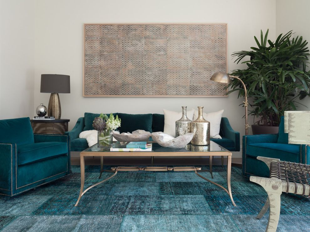 Teal Accent Rug with Transitional Living Room Also Flower Arrangment Glass Top Coffee Table House Plants Nailhead Trim Peacock Blue Velvet Sofa Silver Floor Lamp Table Lamp Teal Armchairs Teal Rug Teal Sofa White Pillows