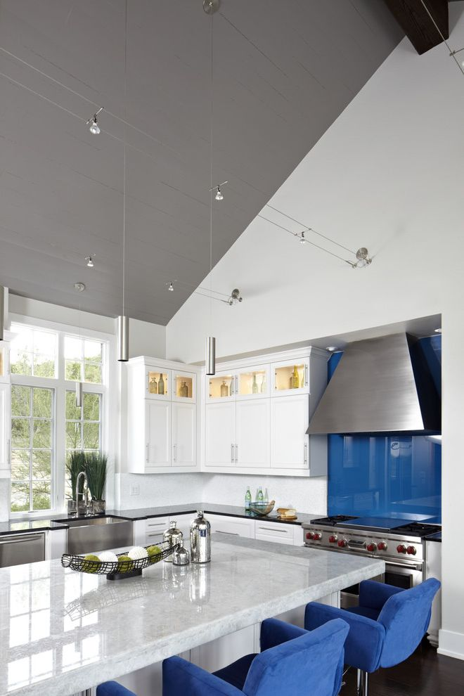 Teche Lighting with Contemporary Kitchen  and Blue Counter Seats Blue Glass Backsplash Glass Front Uppers Pendant Lights Stainless Appliances Stainless Farm Sink Vaulted Ceiling