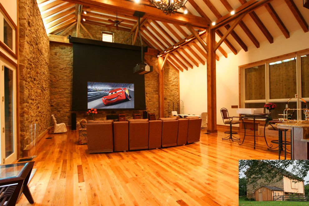 Terra Vista Theater   Rustic Spaces  and Exposed Beams Great Room Home Theater Projection Screen Rustic Sloped Ceiling Stone Walls Vaulted Ceiling Wood Columns Wood Flooring Wood Trim