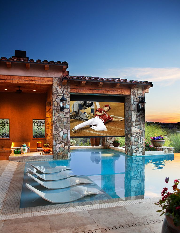 Terra Vista Theater with Mediterranean Pool Also Backyard Deck Jets Gas Lanterns Movie Screen Theater Negative Edge Recessed Lighting Sconce Shear Descent Stone Stucco Swim Up Bar Terra Cotta Roof Tiles Water Lounges
