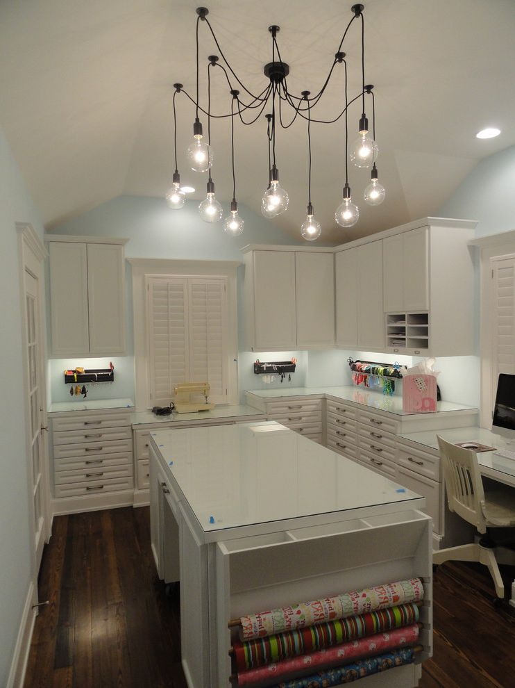 Texas Audio Customs with Traditional Home Office Also Built in Desk Craft Room Desk Drawer Storage File Drawers Home Office Lighting Louvered Shutters Pendant Lights Ribbon Storage Scrapbooking White Cabinets Wood Flooring Wrapping Center Island