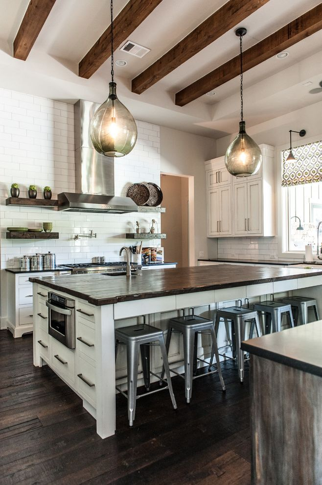 Texas Audio Customs with Transitional Kitchen  and Counter Stools Floating Shelves Kitchen Island Open Shelves Open Shelving Pendant Lights Pot Filler Printed Roman Shade Rustic Wood Floor Stainless Steel Hood Subway Tile White Cabinets Wood Beams