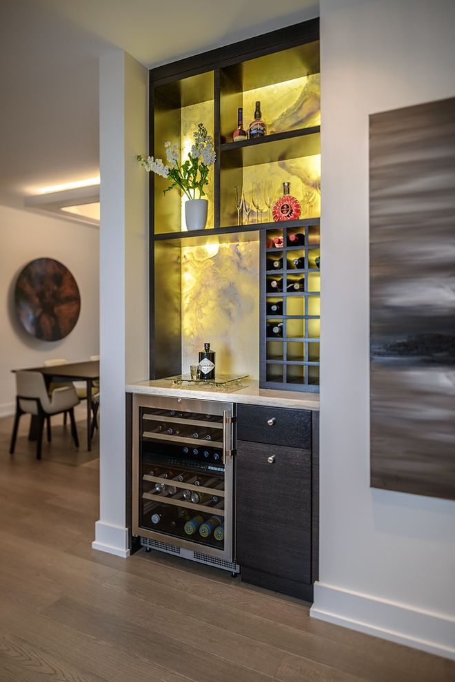 The Bar Method Princeton with Contemporary Wine Cellar Also Artwork Backlit Minibar Bar Baseboard Built in Compact Dark Stained Wood Dining Area Open Shelving Wall Art White Walls Wine Cooler Wine Storage Wood Floor