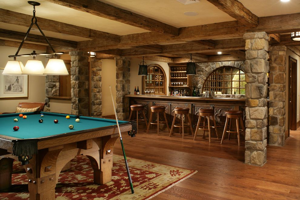 The Bar Method Princeton With Craftsman Basement And Area Rug Chandelier  Exposed Beams Framed Artwork Home