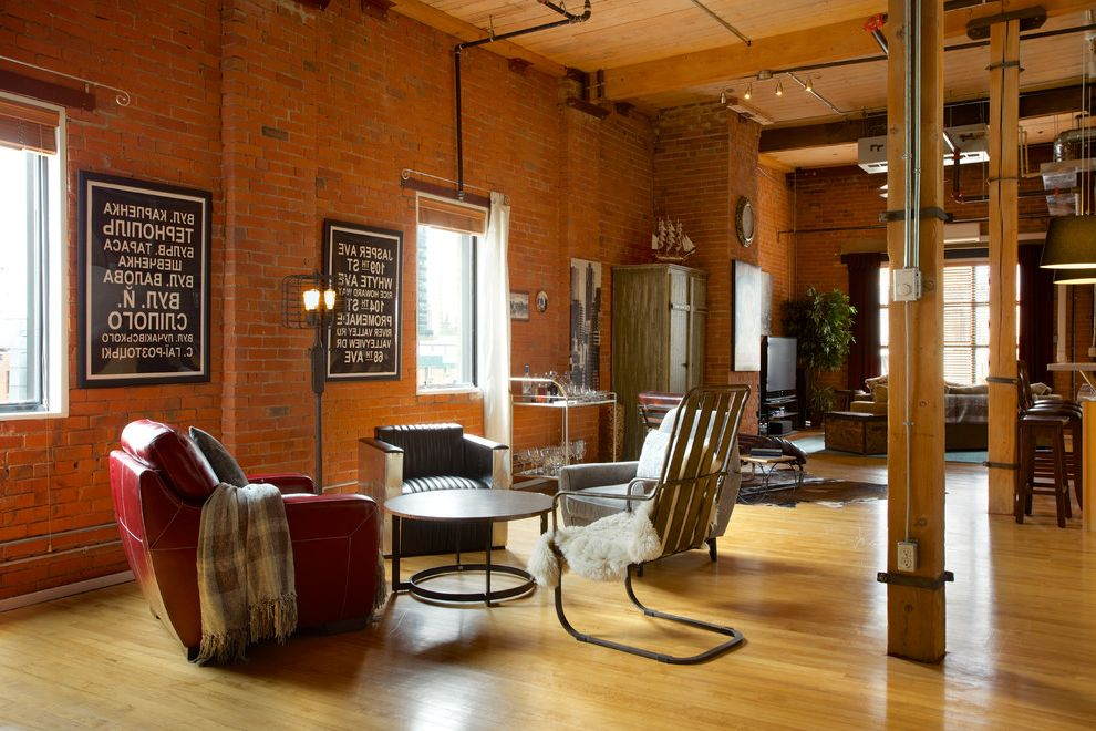 The Colonnade Apartments Phoenix   Industrial Living Room Also Antique Mirror Bar Cabinet Bar Cart Bus Sign Converted Warehouse Cow Hide Rug Exposed Brick Hard Loft Leather Chaise Loft Apartment