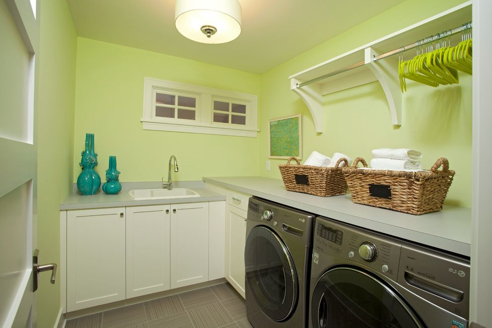The Laundry Room Las Vegas   Beach Style Laundry Room  and Built Ins Drum Pendant Drying Rack Front Loading Washer and Dryer Lime Green Walls Shelves Tile Floors Utility Sink White Cabinets White Trim Wicker Baskets
