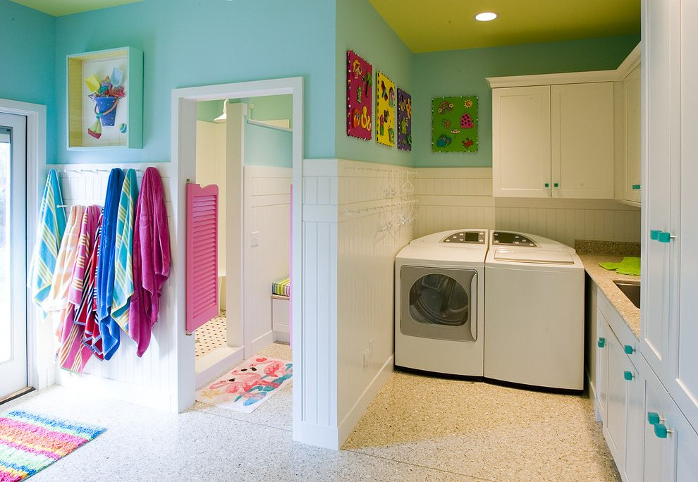 The Laundry Room Las Vegas   Eclectic Laundry Room  and Beach Towel Hangers Blue Cabinet Pulls Blue Walls Bright Colors Green Ceiling Saloon Doors Whimsical Laundry Room White Wainscoting