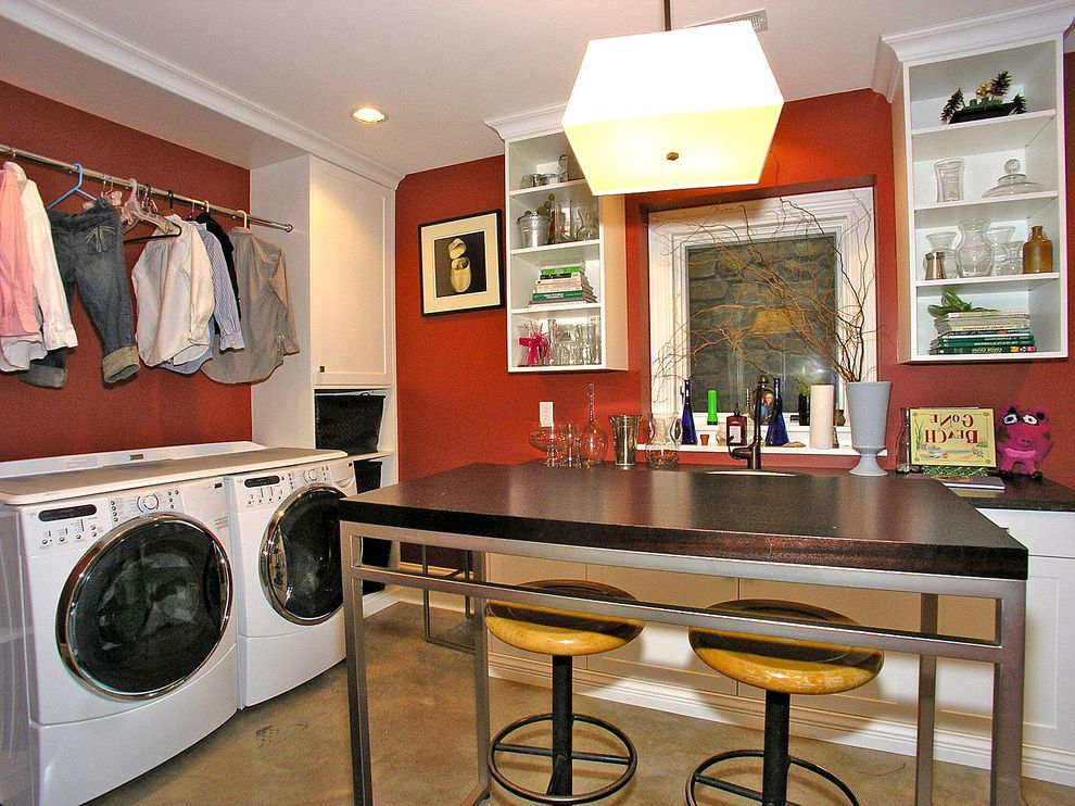 The Laundry Room Las Vegas   Transitional Laundry Room  and Ceiling Lighting Craft Room Crown Molding Dryer Rack Front Load Washer and Dryer Open Shelves Pendant Lighting Recessed Lighting Red Walls White Wood Wood Molding