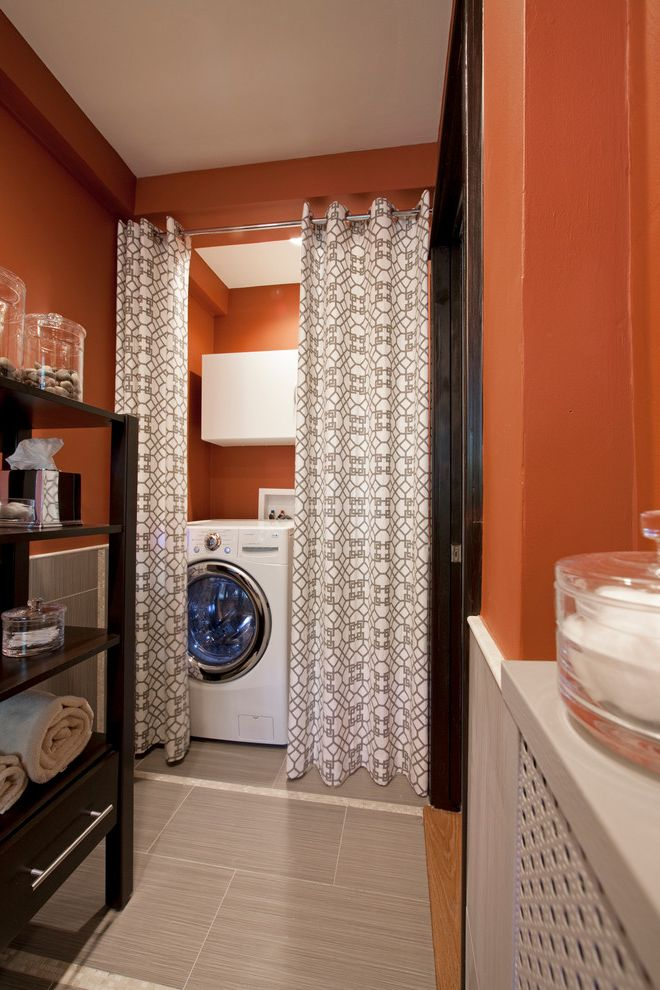 The Laundry Room Las Vegas with Contemporary Laundry Room Also Curtain Divider Curtain Rod Front Loading Washer and Dryer Laundry Room Appliances Laundry Room Storage Orange Walls Patterned Curtain Tile Floor