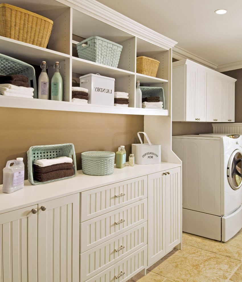 The Laundry Room Las Vegas with Traditional Laundry Room  and Beadboard Cabinets Built in Storage Storage Baskets White Cabinets White Wood Wood Molding