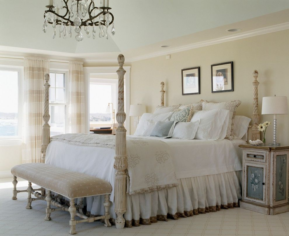 The Light Palace Omaha   Shabby Chic Style Bedroom  and Angled Ceiling Bench Carpet Chandelier Coastal Living Elegant Homes Formal Master Bedroom Four Poster Bed Four Poster Bed New England Homes Cape Islands Upholstered Bench Window Treatment