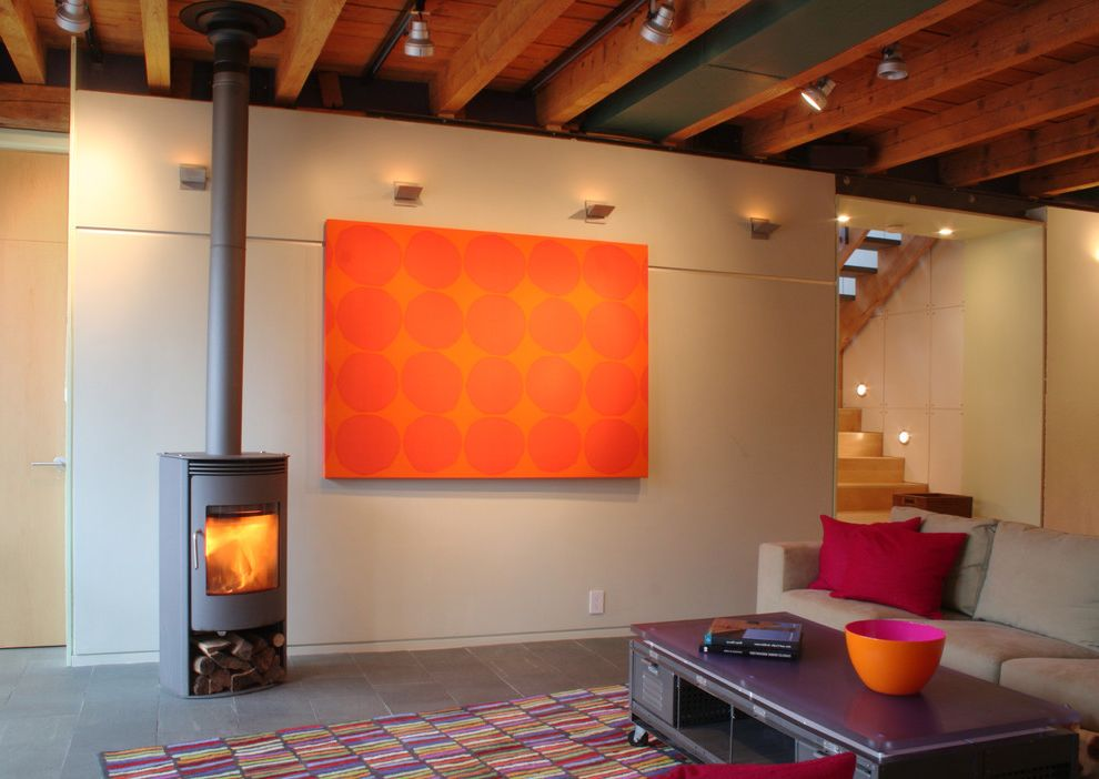 The Light Palace Omaha with Industrial Living Room Also Barn Bold Color Bright Color Fieldstone Fuschia Gym Locker Large Artwork Marimekko Modern Woodstove Orange Pink Rais Woodstove Sectional Slate Striped Rug Timber Framing Track Lighting Wood Stove