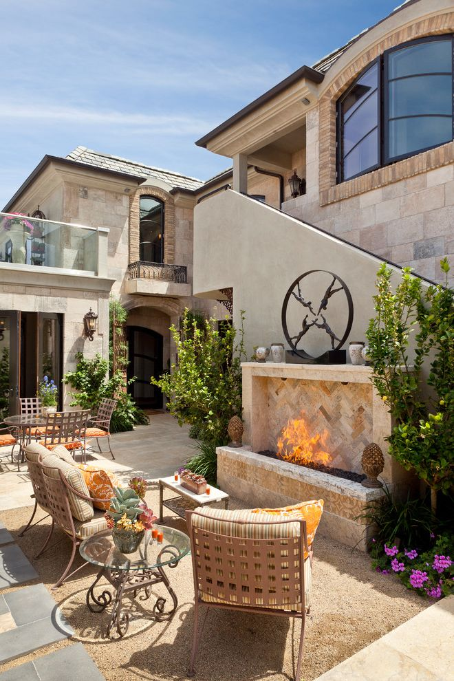 The Pointe at Ramsgate   Mediterranean Patio Also Arched Window Courtyard Deck Limestone Tile Outdoor Fireplace Outdoor Lighting Outdoor Seating Outdoor Staircase Wall Sconce