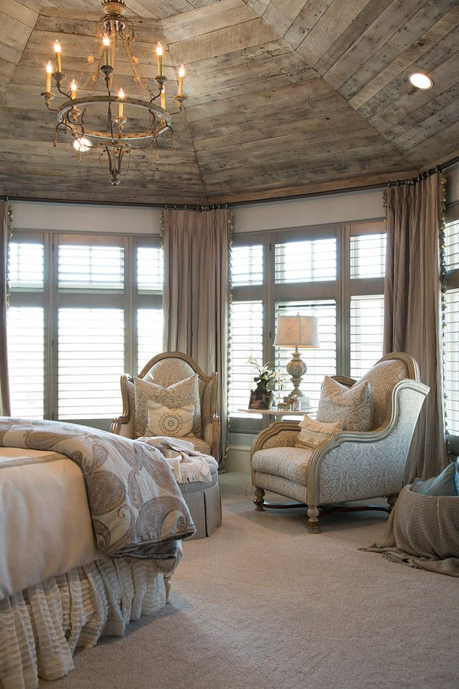 The Woodlands of College Station   Mediterranean Bedroom  and Bay Window Beige Carpet Chandelier Neutral Bedroom Recessed Lighting Upholstered Armchair Wood Ceiling